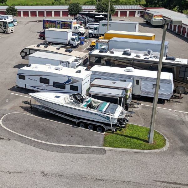 RVs, boats, and trucks parked at StorQuest Self Storage in Phoenix, Arizona