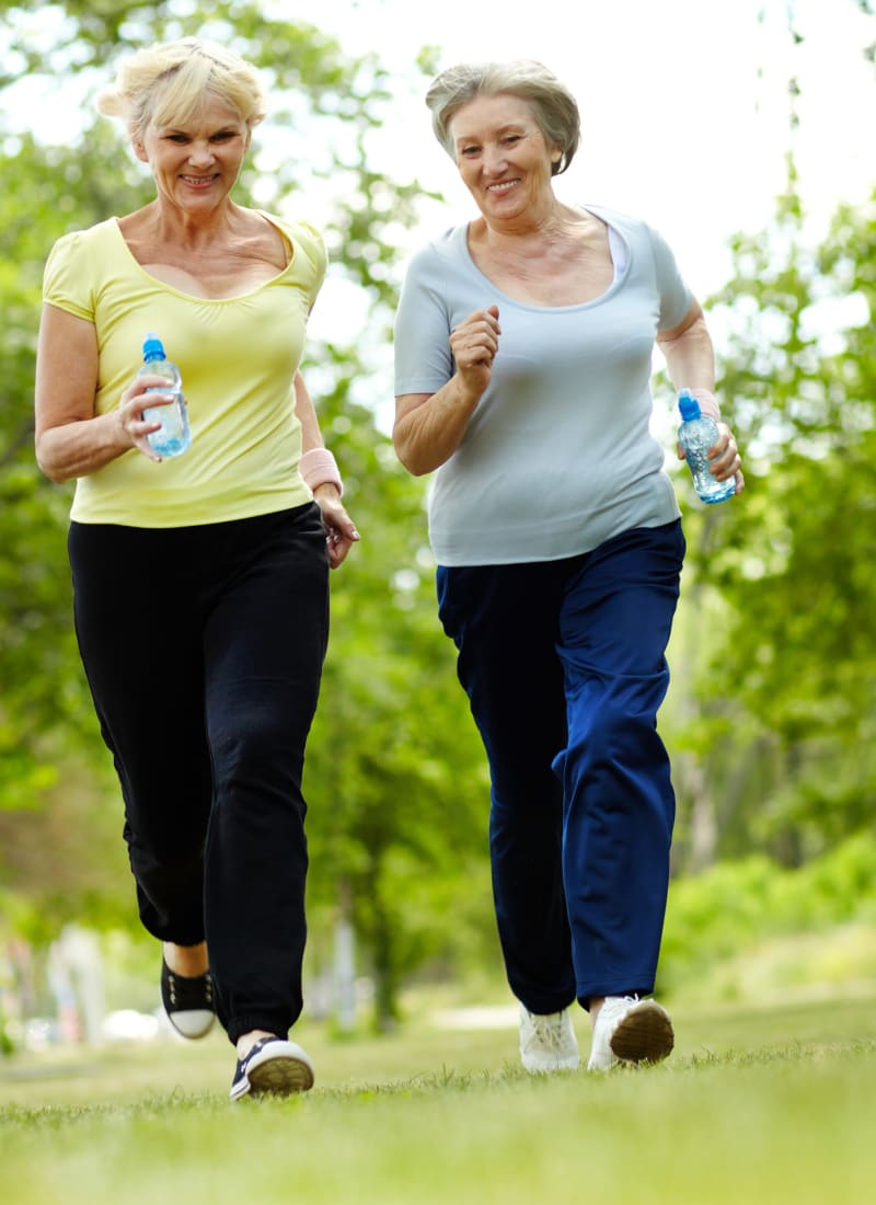 Residents enjoying a walk together near Marquis Rockwall in Rockwall, Texas