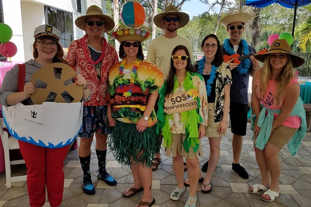 A group of people at a Hawaiian themed party near Discovery Senior Living in Bonita Springs, Florida