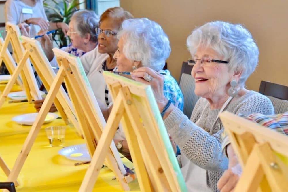 Residents painting together at Merrill Gardens at Rancho Cucamonga