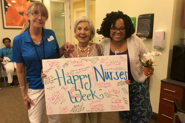 Residents and staff holding a sign for nurse week at Discovery Senior Living in Bonita Springs, Florida