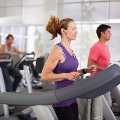 Residents using machines in the fitness center of Kestrel Park in Vancouver, Washington