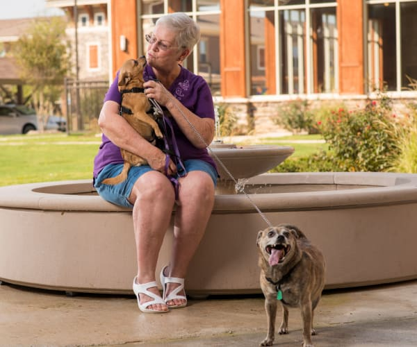 A women with her dogs at a community managed by Integrated Real Estate Group, based in Southlake, Texas