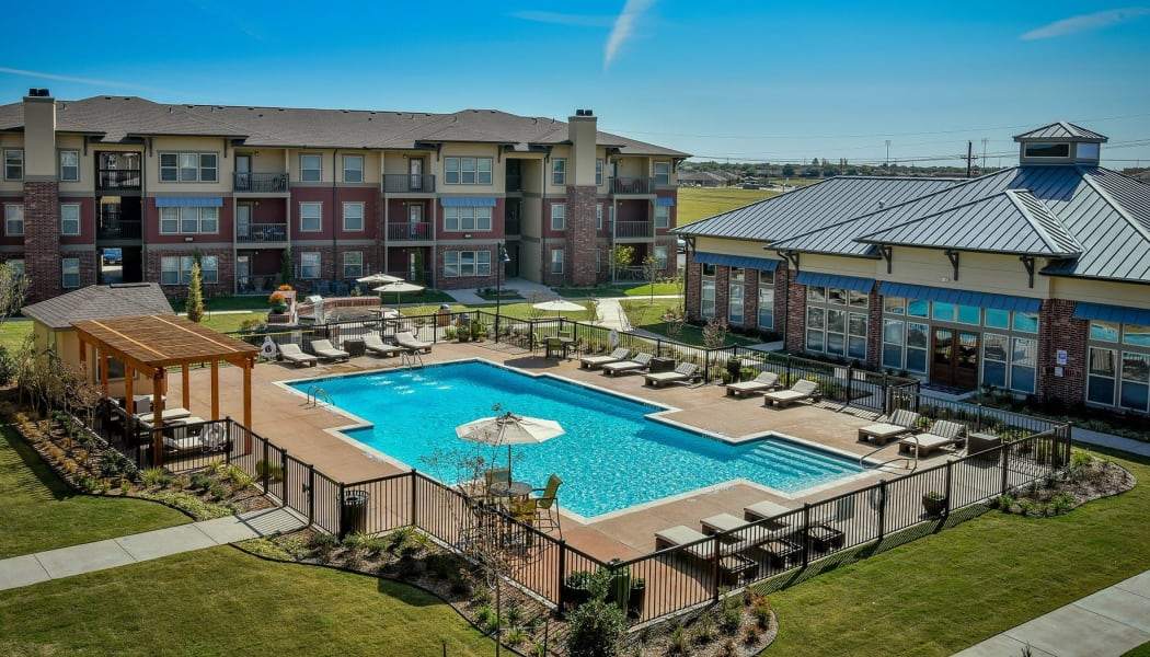 Aerial view of Nickel Creek Apartments's gated community swimming pool in Tulsa, Oklahoma