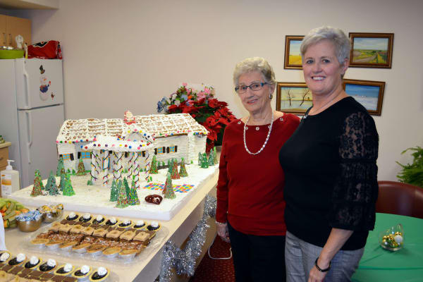 Making gingerbread houses at Victoria Park Personal Care Home in Regina, Saskatchewan