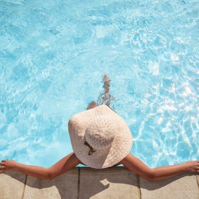Resident lounging in the swimming pool at Sofi Danvers in Danvers, Massachusetts