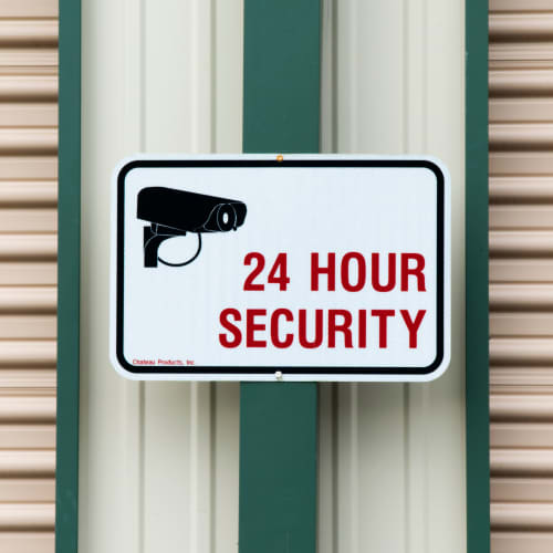 A 24 hour security sign at Red Dot Storage in Mossville, Illinois