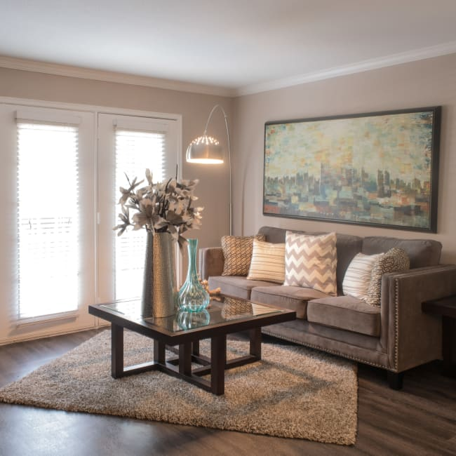 Well-decorated living room in model home at Hayden at Enclave in Houston, Texas