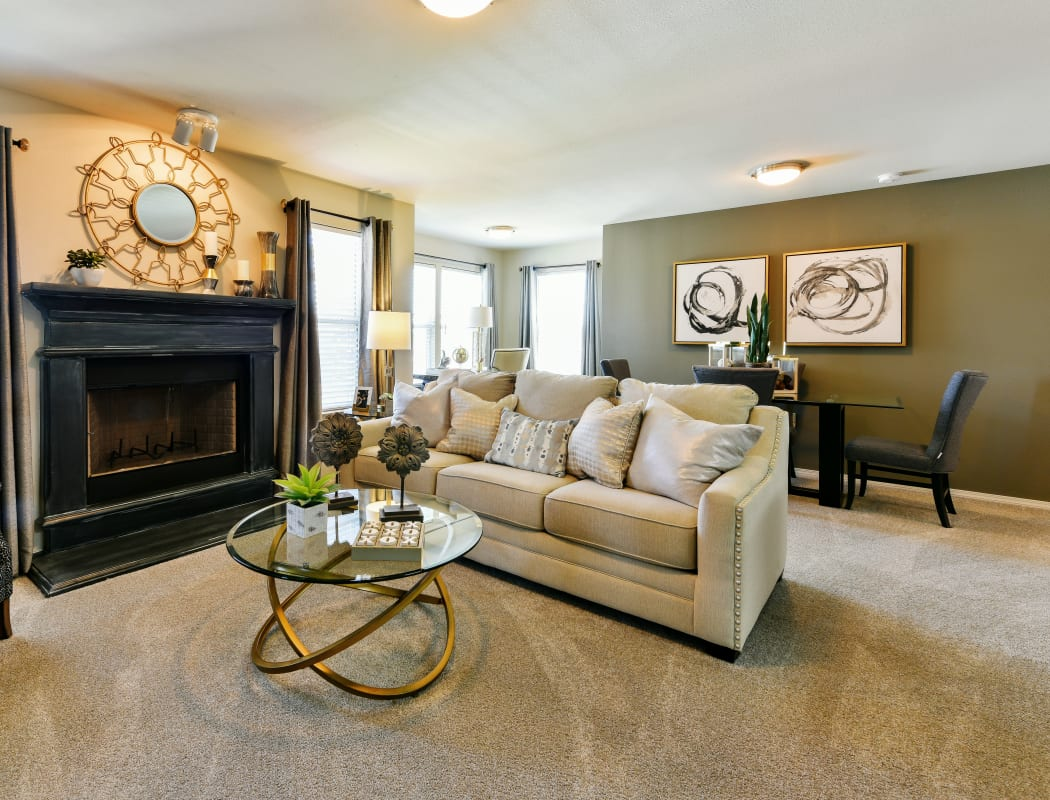 Beautiful, spacious living room at Cottages at Abbey Glen Apartments in Lubbock, Texas