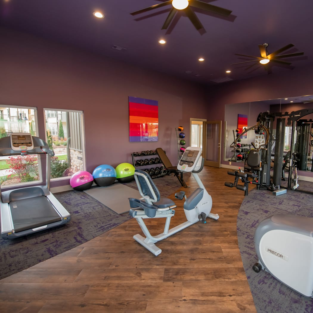 24-hour fitness center at Bend at New Road Apartments in Waco, Texas