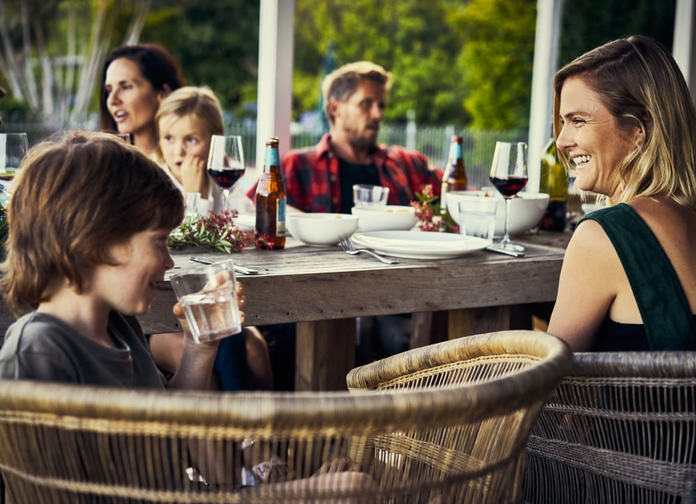 Resident family enjoying food and drinks at a restaurant near Bonterra Apartments in Fort Wayne, Indiana