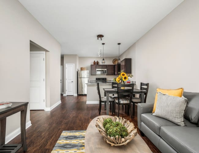 Open-concept layout with hardwood flooring in a model home at Bonterra Apartments in Fort Wayne, Indiana