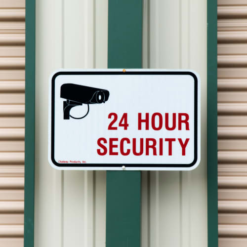 A sign for 24 hour security at Red Dot Storage in Heath, Ohio