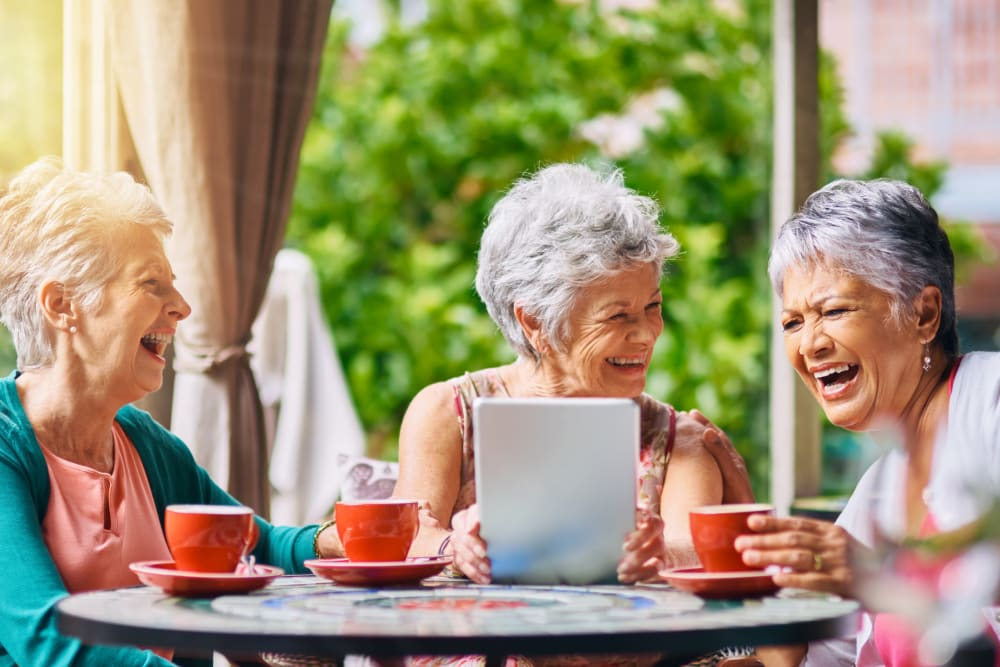 Three residents having drinks together at Cypress Place in Ventura, California