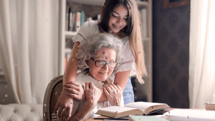 Granddaughter reading with grandmother