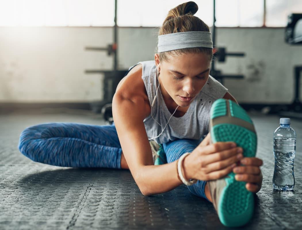 Woman exercising at Portofino Apartments in Wichita, Kansas