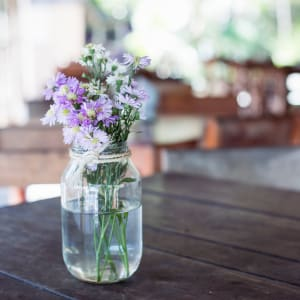 Purple flowers in a mason jar at Paragon at Old Town in Monrovia, California