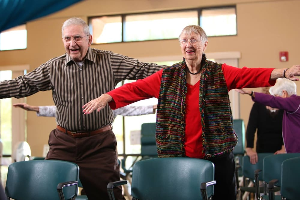 Resident couple doing exercise/dance class at Brookstone Estates of Mattoon South in Mattoon, Illinois