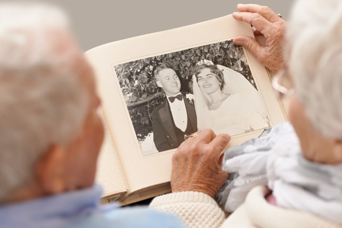 Two people looking at photos at Canoe Brook Assisted Living in Duncan, Oklahoma
