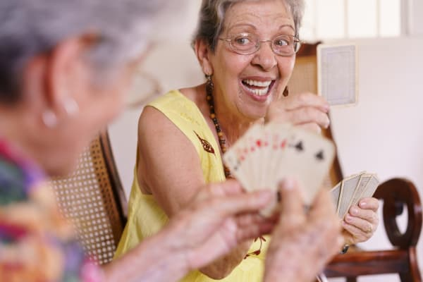 Oakleaf Senior Living residents engaging in a fun game of cards.