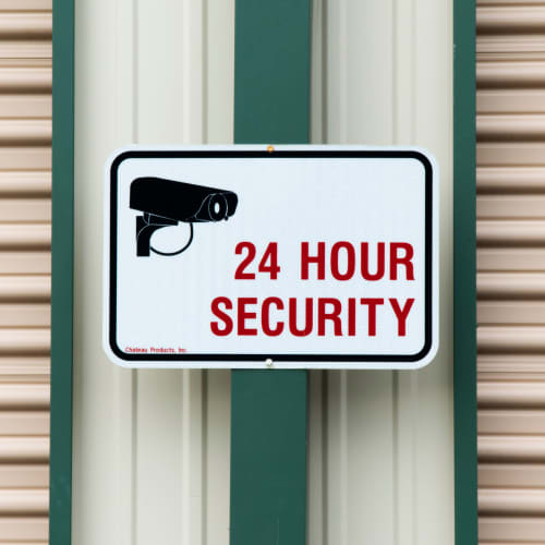 A 24 hour security sign at Red Dot Storage in New Palestine, Indiana