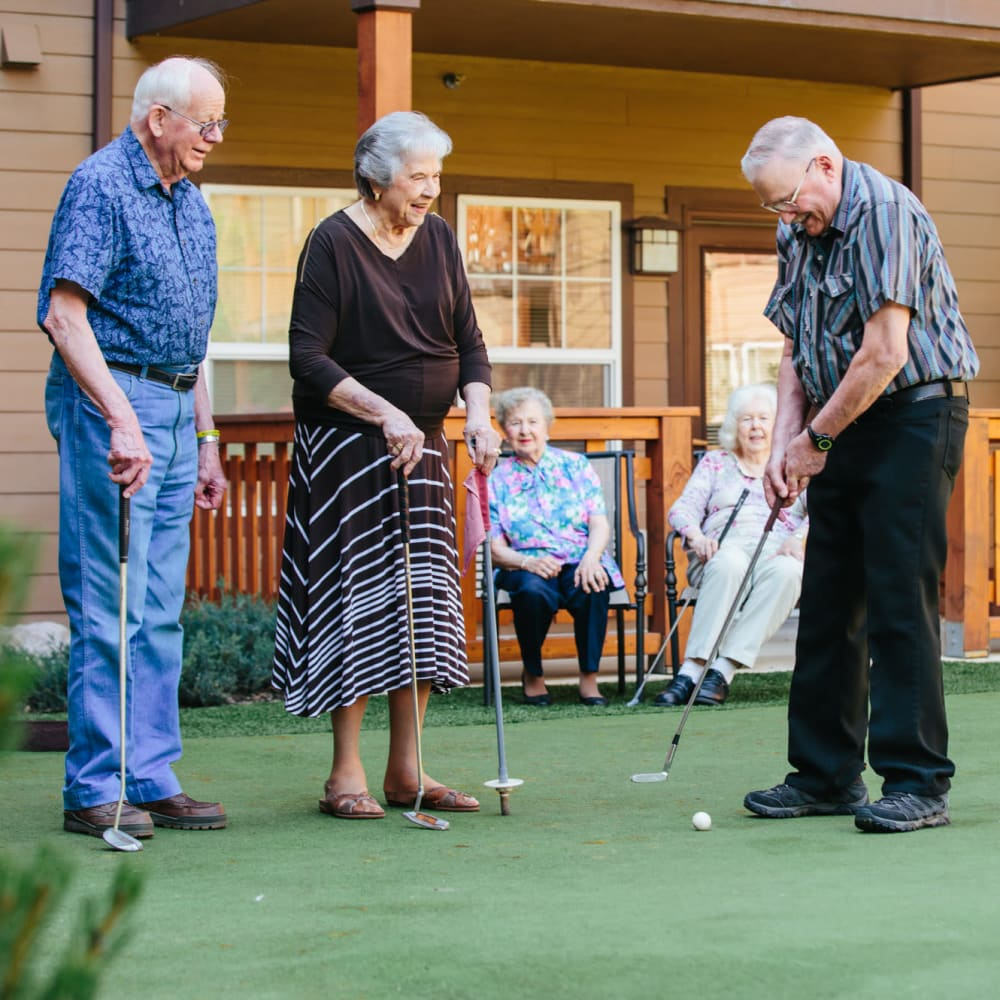 Residents playing mini golf at The Springs at Happy Valley in Happy Valley, Oregon