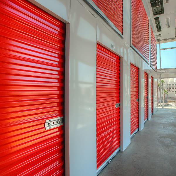 Indoor storage units with red doors at StorQuest Self Storage in Phoenix, Arizona