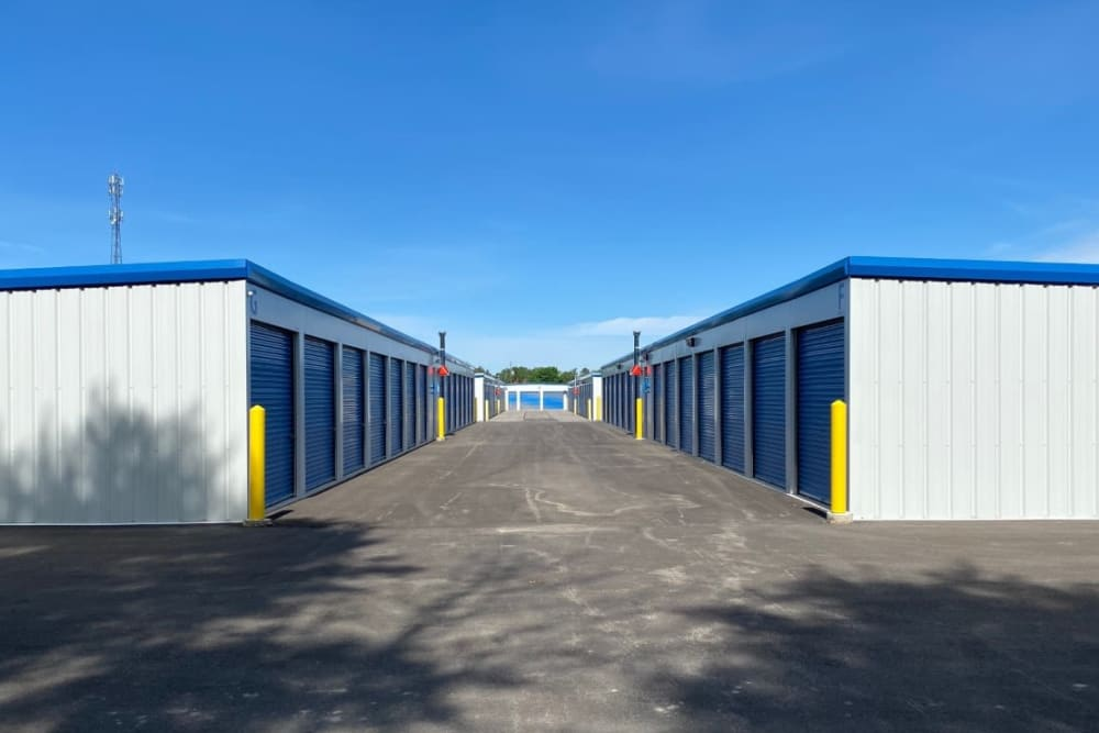 Drive-up storage units with wide driveway at Vault Self Storage in Holland Landing, Ontario