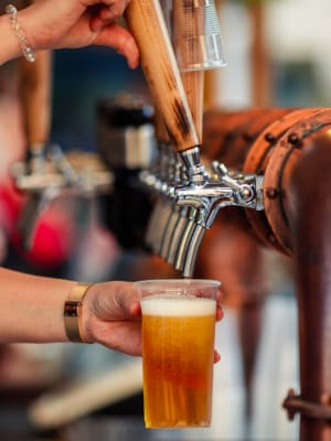 A drink being poured at a brewery near Hawthorn Village Apartments in Napa, California