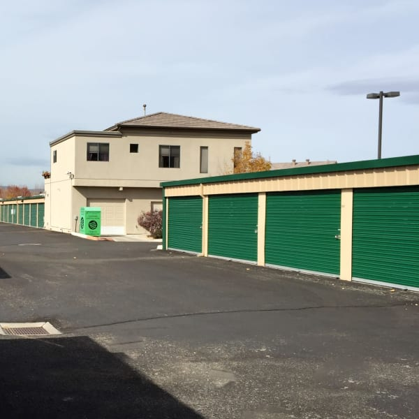 Outdoor storage units with green doors at StorQuest Self Storage in Reno, Nevada