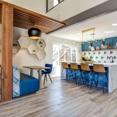 Resident clubhouse lounge and demonstration kitchen at Veranda La Mesa in La Mesa, California