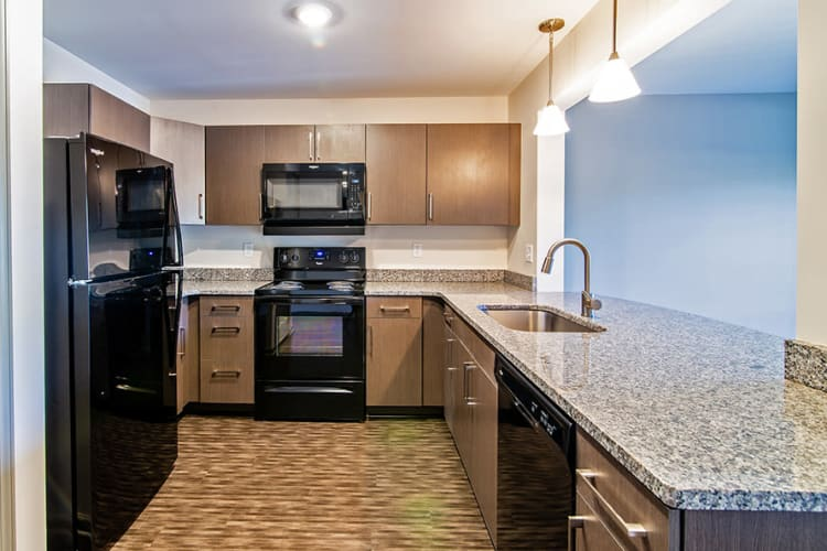 Modern kitchen at Greenwood Cove Apartments in Rochester, New York