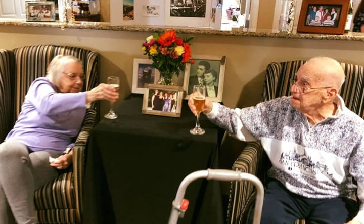elderly couple toasting on their 69th wedding anniversary
