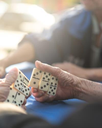 People playing dominos at Kenmore Senior Living in Kenmore, Washington