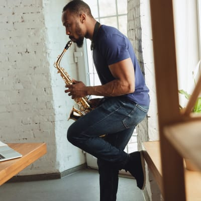 Residents practicing his saxophone in his new home at The Station at River Crossing in Macon, Georgia