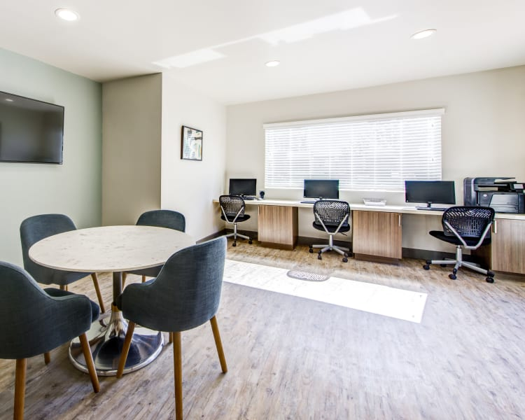 Business center with multiple workstations at Sofi Poway in Poway, California