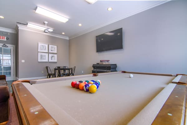 Pool table and flat screen TV at Reserve at Long Point in Hattiesburg, Mississippi