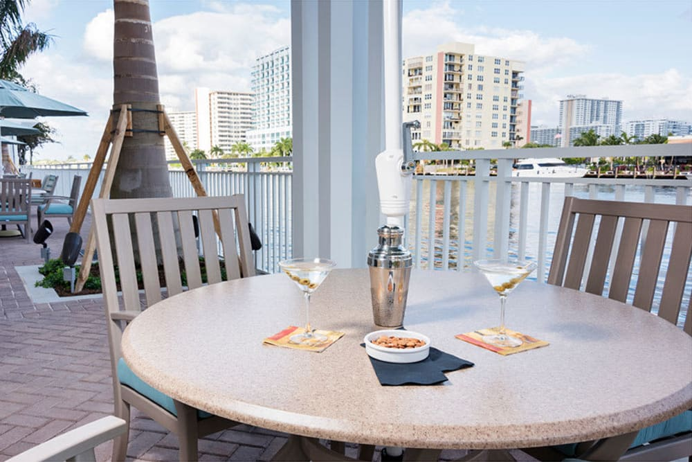 Outdoor dining with views at The Meridian at Waterways in Fort Lauderdale, Florida.