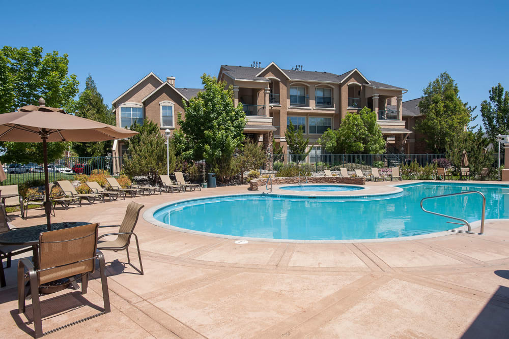 Swimming pool with a large sundeck at The Vintage at South Meadows Condominium Rentals in Reno, Nevada