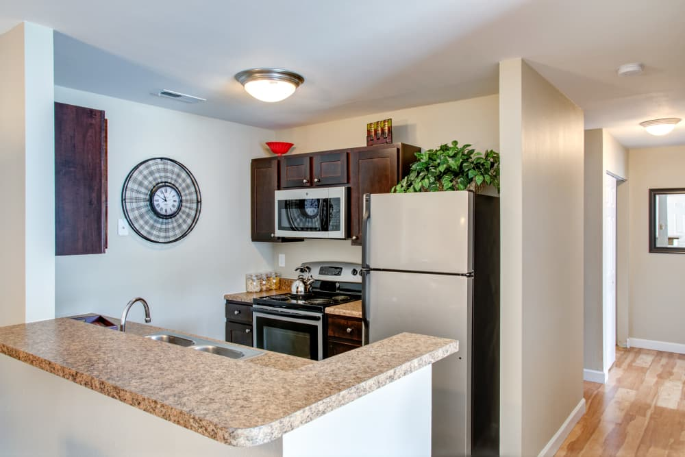 Kitchen dining room combo at apartments in Florissant, MO
