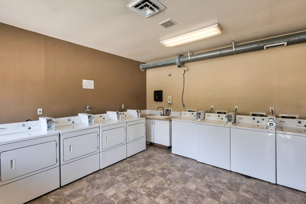 Laundry room at Arbor Crossing Apartments in Boise, ID
