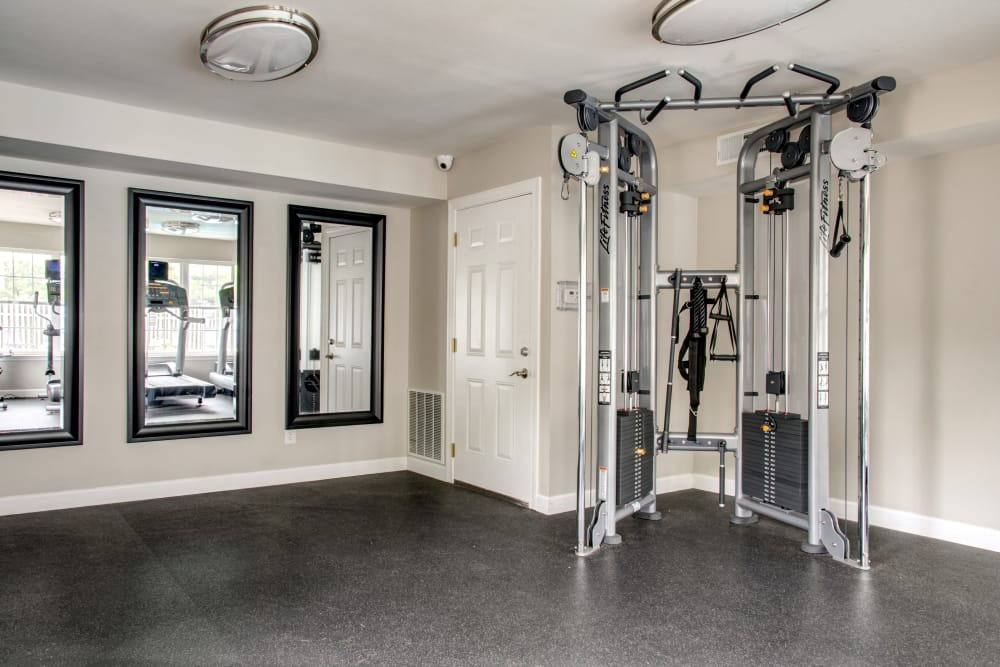 Fitness center at apartments in Florissant, MO