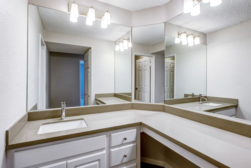 Large L-shaped countertop in a model home's master bathroom at Sofi Irvine in Irvine, California