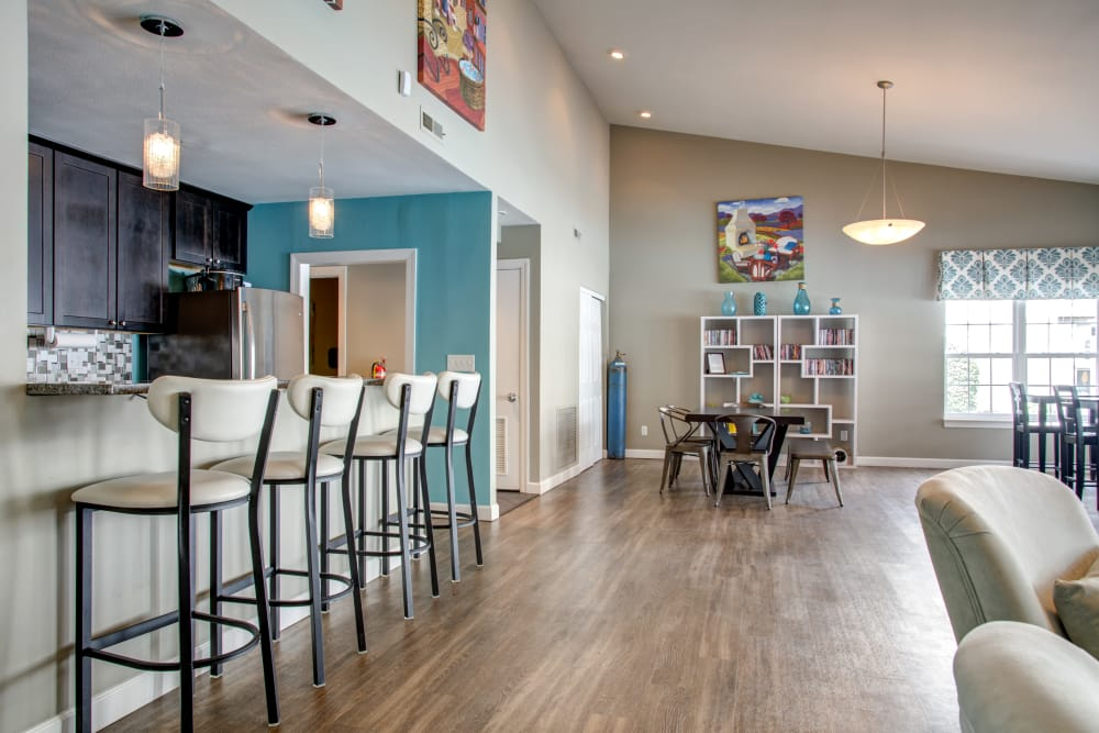 Kitchen living room combo at apartments in Florissant, MO