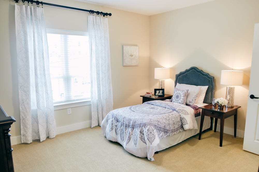 A furnished bedroom at Harmony at West Ashley in Charleston, South Carolina