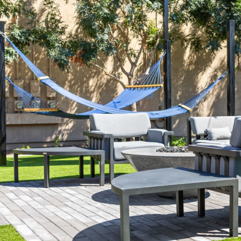 An outdoor patio with hammocks at 1408 Casitas at Palm Valley in Avondale, Arizona