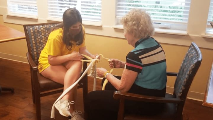 Harvester Place Memory Care teams with local summer campers to help local animal shelter