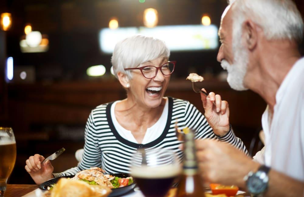 Couple chatting over dinner at River Commons Senior Living in Redding, California