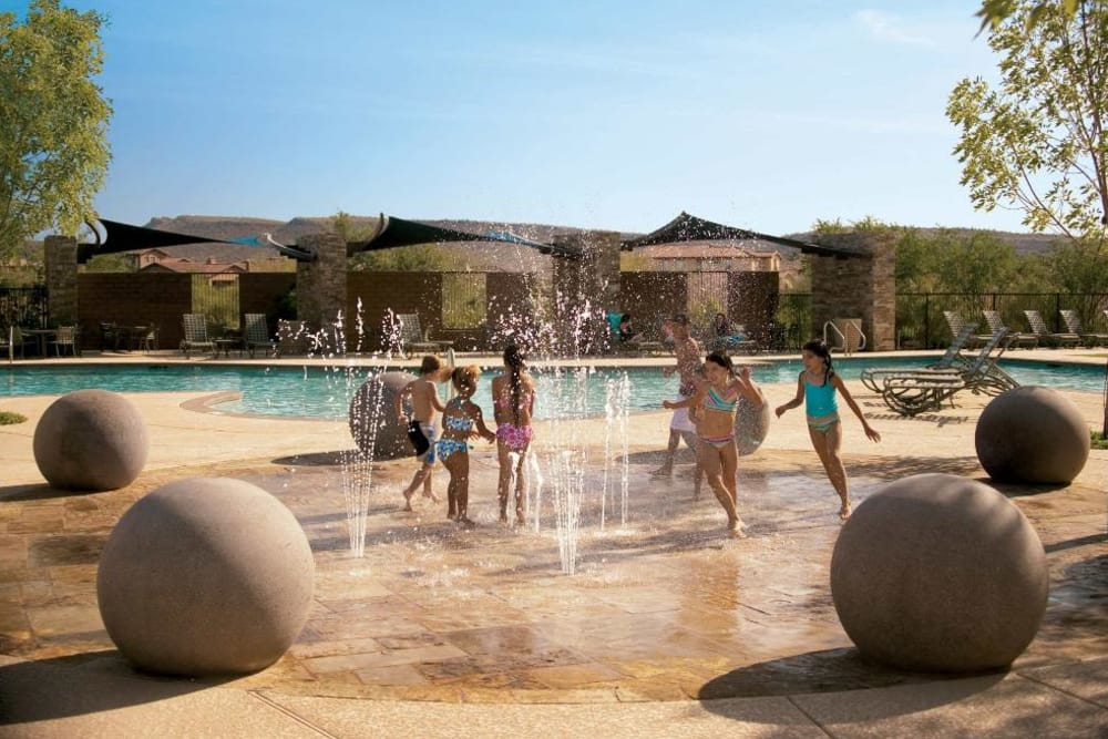Children playing on the splash pad at Vistancia in Peoria, Arizona