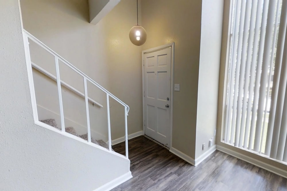 Entrance to an apartment at Falls of Maplewood Apartments in Houston, Texas